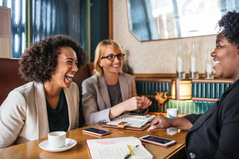 A group of women laughing and networking
