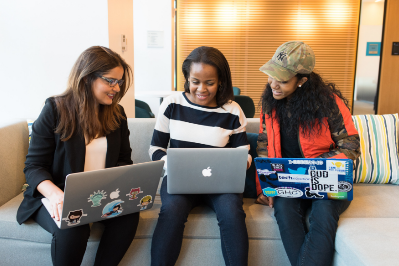Women working on laptops together