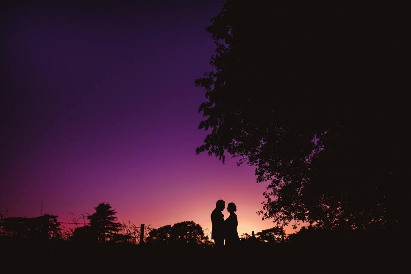 A dramatic wedding photo taken at sunset