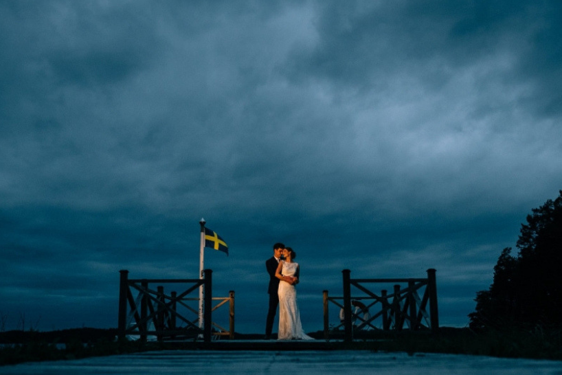 Wedding photography in Sweden, showing a couple against a dark sky