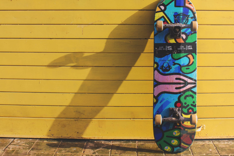 Bespoke skateboard leaning against wall