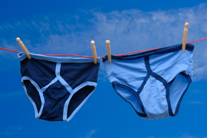 A photo of underwear hanging on a washing line