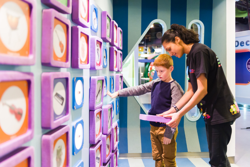 A young boy at a children's museum