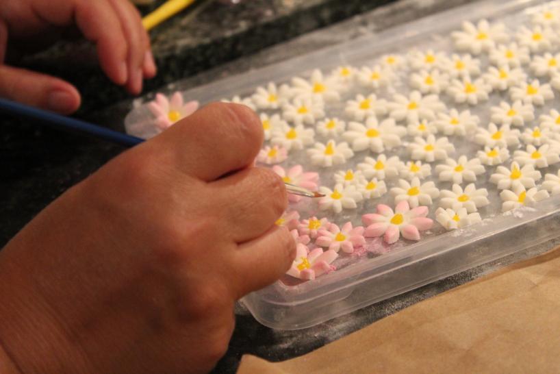Emma decorating sugar flowers